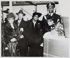 Image Title:  Baltimore honors native son. Alternate Title: [African American Captain Godfrey standing with four relatives of John H. Murphy, Sr. (from left to right: Mr. and Mrs. George B. Murphy, Sr., son and daughter-in-law; Mrs. John Murphy; and Miss Frances Murphy, daughter) at the launching of the Liberty ship bearing his name. Bethlehem-Fairfield Shipyard, Baltimore, Maryland, March 29, 1944.]