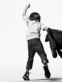 Child playing, sweater, cropped pants, sneakers, jacket