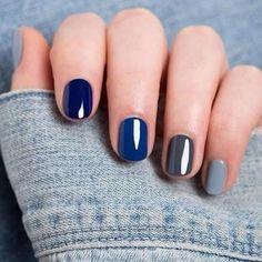 Unghie in gradazione di colore grigio e blu