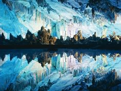 Reed Flute Cave, located 5 kilometers (3 miles) from the city of Guilin in Guangxi, China, is named for the reeds that grow outside the entrance which can be made into flutes. The cave itself is over 180 million years old, and has seen visitors for over 1200 years, which is known due to the existence of over 70 ink inscriptions inside the cave, dating back to 792 AD in the Tang Dynasty. Also, there is a lovely park outside the cave, with gardens, pagodas, ponds, and peaceful pathways