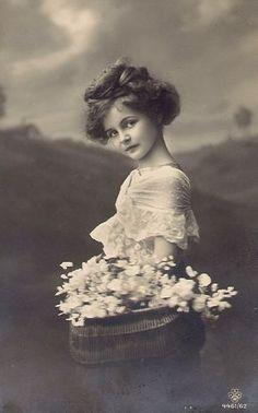 Lovely girl with flower basket