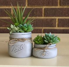 Give any room in your home or office a beautiful touch with this charming artificial succulent mason jar decor. These painted mason jars are the perfect addition to any space. Keep this succulent planter for years worry free. It makes the perfect gift for Mason Jar Succulents, Faux Succulents, Succulents Garden, Succulent Planters, Mason Jar Planter, Plants In Mason Jars, Hanging Planters, Cheap Planters, Tall Planters