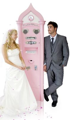"A couple tie the knot at the charming Cadillac pink ""Auto Wed"" machine with florescent display."