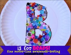 B is for Beads! Part of the 31 Days of ABCs series. Create bead collage art while working on tip-to-tip finger grasp, line awareness, and sorting. #TheSugarAunts #beads #art