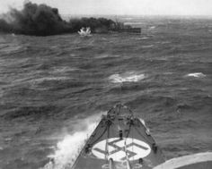 Off Norway, destroyer HMS Glowworm under attack by German heavy cruiser Admiral Hipper, as British ships surprise the German invasion fleet bound for Norway, 8 April 1940.