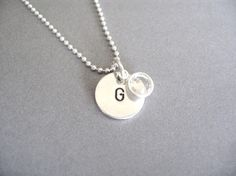 Mother's Necklace style... Personalized, custom, charm necklace with birthstone. Wear the initials of the people who mean the most to you, plus their birthstones close to your heart with this beautiful, classic sterling silver personalized charm necklace with a sterling silver bezel set SWAROVSKI crystal charm. From Timbro D'Amore Boutique.