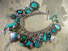 My collection of charms and pendants pulled together to create this awesome, one of a kind, turquoise charm bracelet!  22 charms in all. Some pendants are signed or stamped, some are not. All are real Navajo or Zuni sterling silver and turquoise jewelry, handmade and vintage. Finished with a vintag