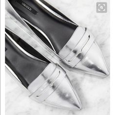 F21 Silver Loafers These are highly coveted and sold out. And why I chose to buy a half size smaller than my normal size is beyond me I soo wish these fit! Tried on in the house and quickly confirmed they didn't so brand new for you lucky gals with size 7 feet. Shoes Flats & Loafers