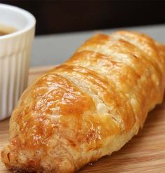 In this version of Baked Bangers and Mash Rolls with Onion Gravy, the ingredients are rolled into a puff pastry shell and baked in the oven until golden brown.