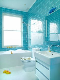 Modern Family Bathroom By Suzy Hoodless Blue Subway Tile On Walls White Fixtures Works For Big Little Kids