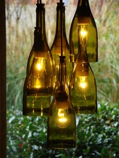 Cluster Style Wine Bottle Chandelier.  This Chandelier is made from six Chardonnay bottles hanging in a cluster. They are hanging from a pan lid for a ceiling mount. The pan lid is black, but it would be white. Upgrade me to a wooden ceiling mount, under shop sections search wooden ceiling mounts. The cord, sockets and ceiling mount are white but could be black if you specify. The light could be sold with a plug in, instead of being hardwired, just let me know. The light hangs down 38 but…