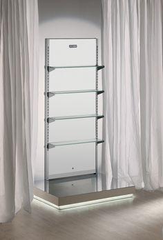 www.salonambience.com/fr 165*199 p 20, fond blan étagère verre. 1140 €. socle bois laqué ??? étagères supplémentaires ?