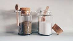salt and pepper cork jars with little wooden spoons
