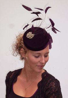distinguished UNIQUE 100% handmade minihat / fascinator aubergine velvet on aliceband. $139.00, via Etsy.