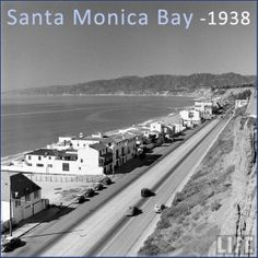 This is the Pacific Coast Highway, Santa Monica in 1938—probably somewhere near the California Incline, I'd say. It looks so calm and peaceful (and easy to find a park), doesn't it? I can see a total of FIVE cars on PCH.
