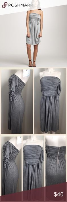 J. Crew Strapless Grey Dress Gorgeous yet simple cascade ruffle dress by J. Crew. Zipper closure on back. Stretchy material. His dress is a versatile style - can be worn from day to night! #4191704 J. Crew Dresses