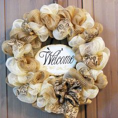 Item #319 - This wreath is gorgeous! The gold deco mesh and black toile burlap perfectly match the plaster welcome sign. The gold accents on the sign shimmer like the gold mesh that surrounds it. This wreath is tasteful and modern with a touch of classic. Its just beautiful
