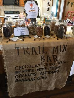 """Trail Mix Bar, perfect for any party with a """"rustic"""" or """"wilderness"""" theme.  My sister did this for a woodland baby shower."""