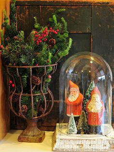 SEASONAL – CHRISTMAS – an old fashioned christmas with vintage and historic ornaments in brilliant color such as this santa cloche.