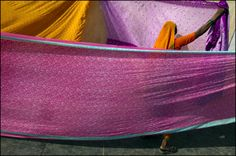A pilgrim from Maharashtra drying Saris on the Ghats in Dwarka.