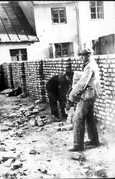Warsaw, Poland, Construction of the ghetto wall. Jews were forced to build the ghetto walls, just as they were forced to build the death camps