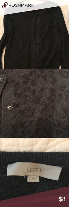 Ann Taylor LOFT black cheetah cardigan Perfect for work, school, church, or business casual. This black cardigan has a little flare with a shimmering threaded cheetah print. LOFT Sweaters Cardigans