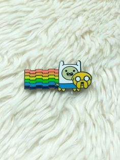 Hey, I found this really awesome Etsy listing at https://www.etsy.com/listing/248557658/adventure-time-hat-pin-nyan-adventure