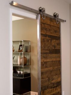 AFTER: A sliding barn door separates the living room from the home office and adds a rustic touch to the decor.