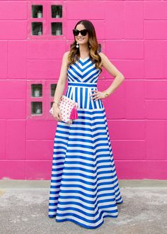 Jennifer Lake Style Charade in a blue and white stripe gown, pink pom pom clutch, white BaubleBar Crispin earrings at a pink wall in Austin Modest Dresses, Casual Dresses, Summer Dresses, Long Gown Dress, Dress Skirt, Skirt Fashion, Fashion Dresses, Maxi Robes, Designs For Dresses
