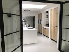 Pivot doors combined with home-made concrete and sleek wood with a white kitchen. Küchen Design, Game Design, House Design, Interior Design, Kitchen Corner, Kitchen Organization, Game Room, Home And Living, Home Kitchens