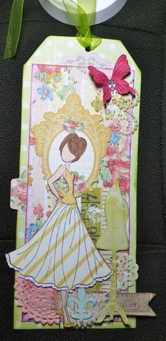 a tag created with Prima's new mixed media doll stamps, tag pad and the Divine collection from Scraputante.com