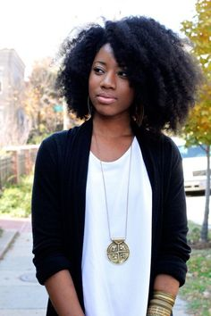 Funky hair and bold accessories makes a white t and cardi look great.
