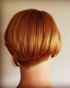 short stacked red bob with shaped undercut