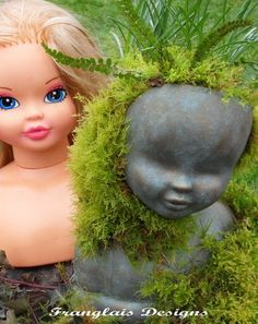 Cut the back half of the doll's head off and fill with cement for an sculptured doll head for your garden.