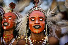visit the Wodaabe people populating the Sahel desert of West Africa to see the tradition of Gerewol dance... it's awesome!