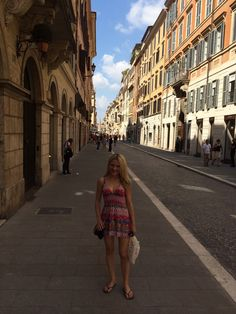 It Girl Weddings  //  Caitlin Sullivan roaming the streets of Rome in short pink dress with tory burch bag http://www.itgirlweddings.com/wifestyle/eat-pray-love