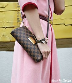 Louis Vuitton Eva clutch as a helpful substitute for a large bag
