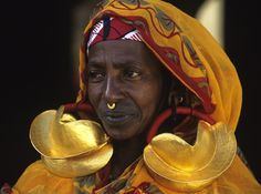 Fulani woman with Gold Earrings by Carol Beckwith and Angela Fisher