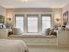 Not a fan of the curtains at all but love the window seat and storage under it