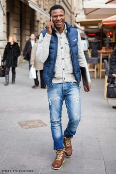 Choose a blue gilet and blue destroyed jeans for a comfortable outfit  that's also put together