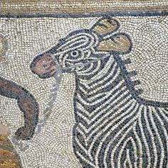 Tesserae (mosaic stones) made of rocks from the riverbed of the Euphrates were used to depict a black man leading a zebra.