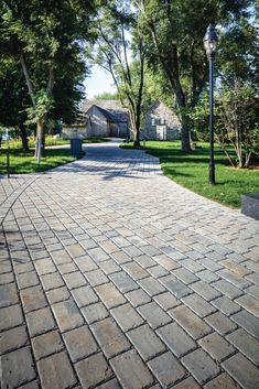 Our Pure paver brings the larger cobblestone look to permeable pavements for residential driveways and patios. It allows for the proper percolation of surface water into the ground; reducing the risk and severity of flooding, eliminating puddles, speeding up the melting process of snow, reduced winter ice hazards and cost-savings on de-icing salt and snow removal! Driveway Design, Driveway Pavers, Paver Designs, Paver Stones, Cost Saving, Pavement, Sidewalk, Backyard, Rustic