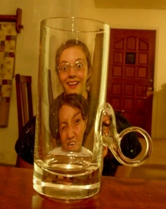 Two silly girls stuck in a glass
