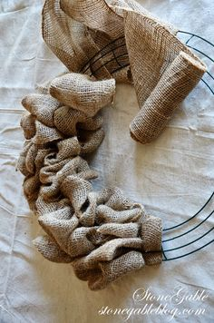 Much easier than my burlap wreaths - StoneGable: BURLAP WREATH TUTORIAL. I've purchased a few wreaths, and I LOVE them. I definitely wanna learn one day to make them myself. This will come in handy! Burlap Projects, Burlap Crafts, Wreath Crafts, Craft Projects, Craft Ideas, Easy Burlap Wreath, Burlap Wreath Tutorial, Diy Wreath, Wreath Ideas