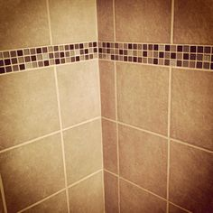 Bathroom wall tiles with colorful glass accents