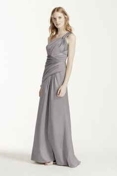 This one shoulder stretch satin dress is perfectlyelegant for any occasion!   One shoulder pleated bodice features split strap detail at the back.  Versatile A-line silhouette.  Lined through the hip. Imported. Back zipper. Dry clean only.