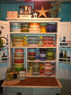 Pyrex display in a vintage Hoosier cabinet...LOVE