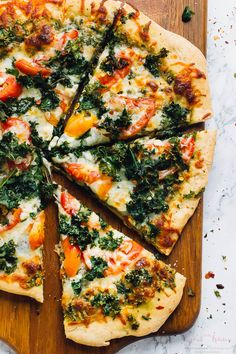 This Kale Pesto Pizza offers double the kale with a garlicky kale-pecan pesto and crispy kale chips on top of this addictive veggie pizza!