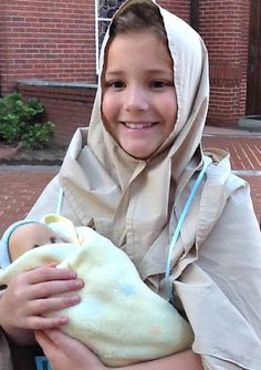 "In honor of All Saints Day 2014, Saint Margaret Catholic School held the ""Parade of Saints.""  The observance began with a prayer service involving kindergarten through eighth grade students, with each student dressed as their favorite saint.  Julia portrayed St. Elizabeth, mother of St. John the Baptist."