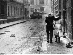 One of the Soviet tanks that crushed the Hungarian Revolution of 1956 lingers on a street corner in Budapest, while a couple hurries past.